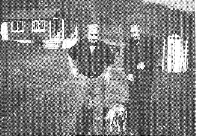 Mahlon and Sherman Korns, with Mahlon Korns' house in the background