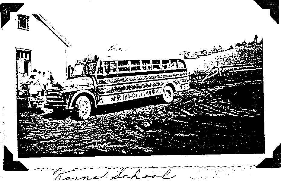 Photo of the Korns School with school bus.